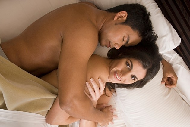 couple-hugging-in-bed-credit-blend-images