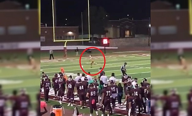Streaker Interrupts Cheerleading Performance At High