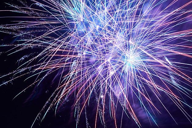 Blue colorful fireworks on the black sky background