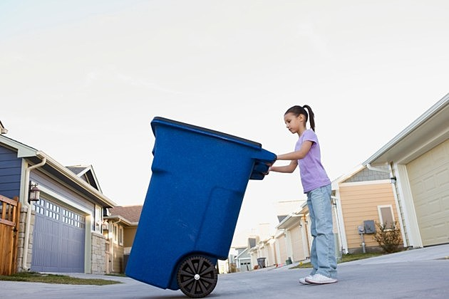 Girl taking out recycling